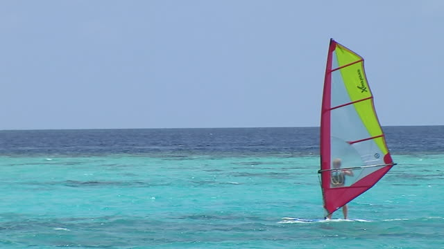 block shot wind surfing male maldives - water sport stock videos and b-roll footage