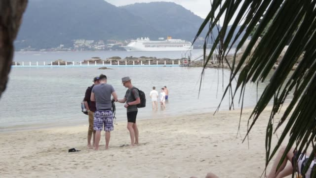 Blockchain Cruise conference guests relax at Paradise Beach as the Mariner of the Seas cruise ship operated by Royal Caribbean Cruises Ltd and host...