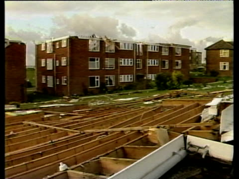 Blocks of flats the with roofs torn off in storm debris scattered around October Storms 1987