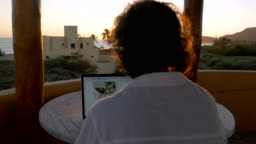 Blogger or graphic designer man working on laptop at home office at beach