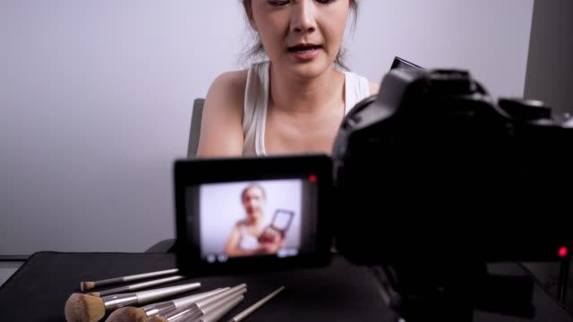 blogger recording makeup on white background 4k - hobbies stock videos & royalty-free footage