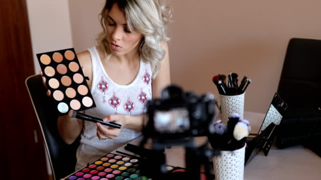 blogger recording makeup tutorial on camera - tutorial stock videos and b-roll footage