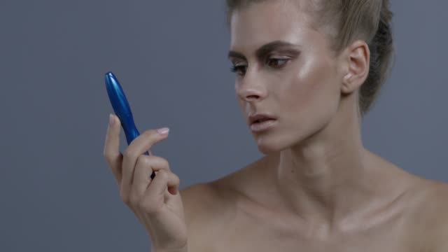 blond fashion model plays with mascara, hissing on it. fashion video. - animal imitation stock videos and b-roll footage