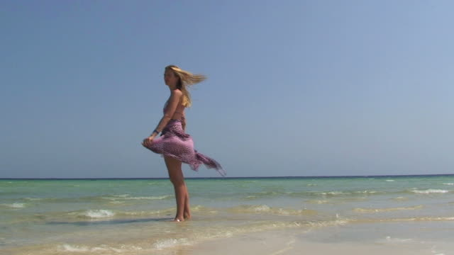 blond girl on the shore - sarong stock videos and b-roll footage