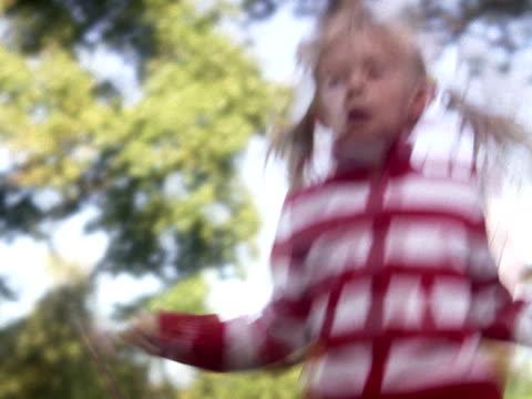 A blond girl skipping Sweden.