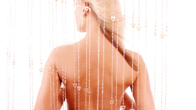 blond girl with bare back - beaded curtain stock videos & royalty-free footage