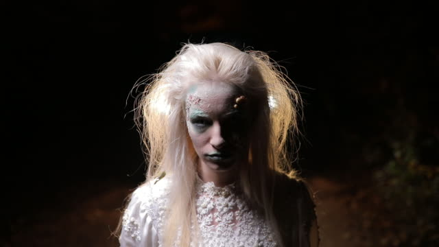 blond hair witch with long white dress - zombie stock videos & royalty-free footage