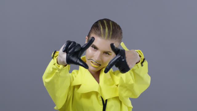 blond high fashion model in bright stage make-up and black leather gloves moves her hands. fashion video. - modern dancing stock videos & royalty-free footage