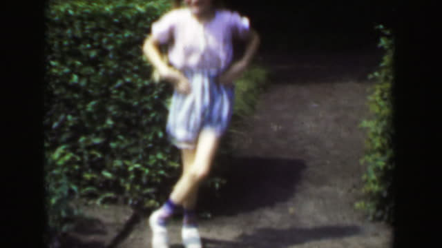 1949: blond long braided hair light skinned girl dancing jig outdoor shorts. - showing off stock videos and b-roll footage