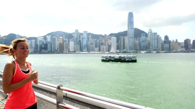 Blond woman jogging in Hong Kong