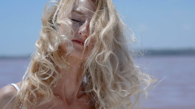 blond woman outdoors - hair toss stock videos & royalty-free footage