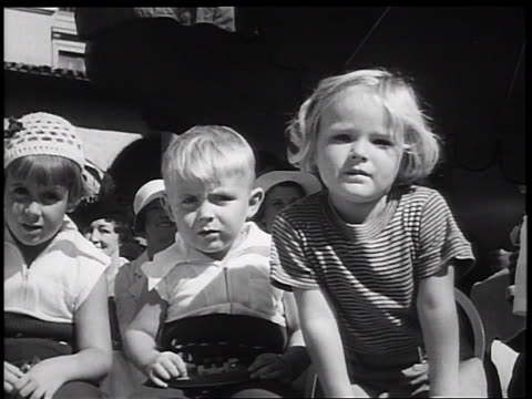 B/W 1936 blonde children looking at camera in children's fashion show / Miami Florida / newsreel