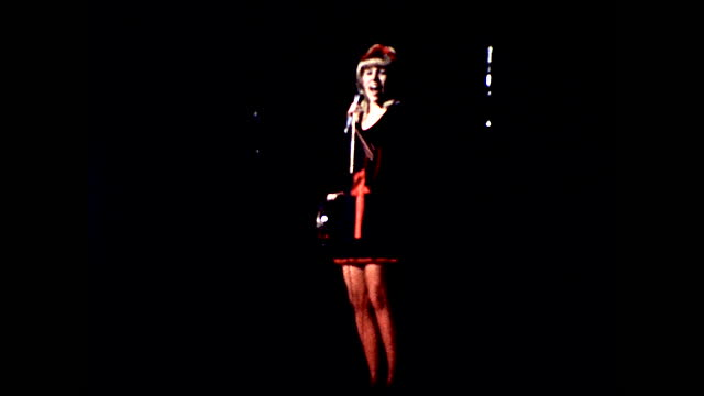 blonde girl in short skirt singing and dancing on stage with a tambourine under the spotlight - 1960 1969 stock videos & royalty-free footage