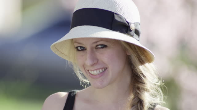 blonde in a hat at a park - straw hat stock videos & royalty-free footage