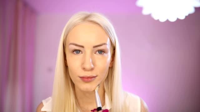 blonde lady make up tutorial - side hustle stock videos & royalty-free footage