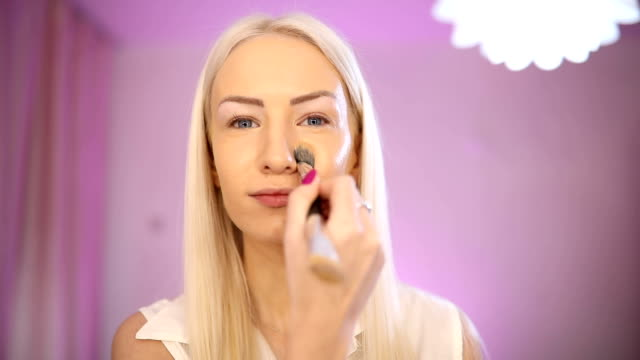 blonde lady putting make up tutorial - side hustle stock videos & royalty-free footage