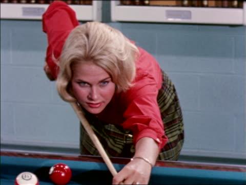 1963 blonde teen girl shooting pool + smiling / industrial - one teenage girl only stock videos & royalty-free footage