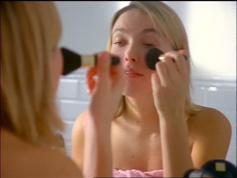 Blonde teen videos Blonde Teen Girl Wearing Towel Looking In Bathroom Mirror Applying Makeup High Res Stock Video Footage Getty Images