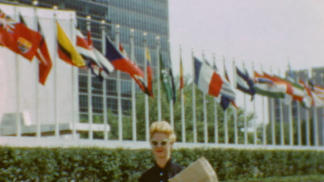 blonde woman at united nations building / view from empire state building / la méditerranée at moma / united nations building on september 20 1955 in... - united nations stock-videos und b-roll-filmmaterial