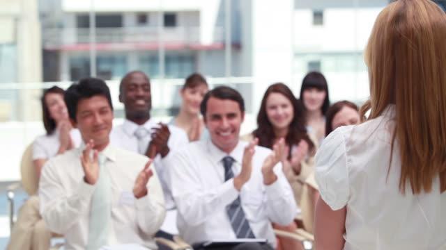 Blonde woman being applauded