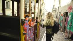 Blonde woman boarding a tram