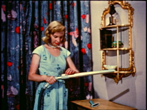1950 blonde woman changing vacuum cleaner attachments + walking offscreen - stay at home mother stock videos & royalty-free footage