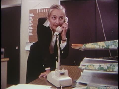 1970 blonde woman in office running to answer phone - 1970 stock videos & royalty-free footage