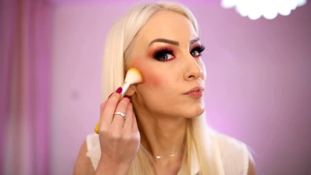 blonde woman make up artist - applying stock videos & royalty-free footage