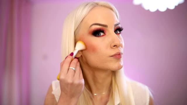 blonde woman make up artist - blusher stock videos & royalty-free footage