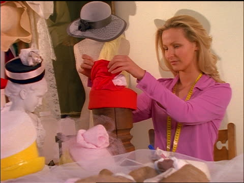 blonde woman making hat in millinery - milliner stock videos and b-roll footage