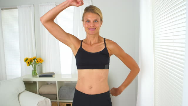 blonde woman showing off her muscles - only mid adult women stock videos & royalty-free footage