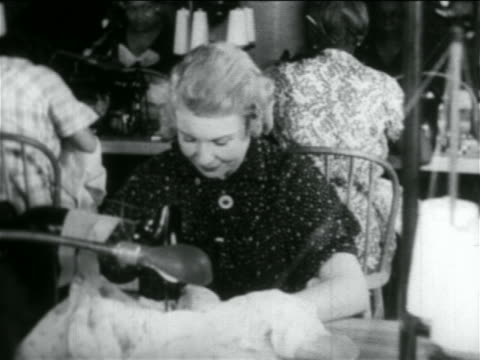 b/w 1934 blonde woman using sewing machine in wpa garment factory / documentary - 1934 stock videos & royalty-free footage