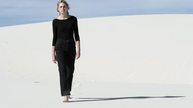 blonde woman wanders in desert, wide - land stock videos & royalty-free footage
