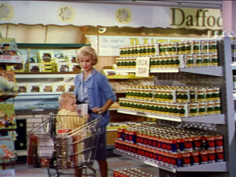 1962 blonde woman with baby in shopping cart stopping at shelf + grabbing canned good / industrial - canned food stock videos & royalty-free footage
