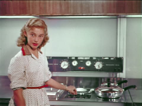1954 blonde woman/teen girl displaying stove + talking to someone off-camera / industrial - 1954 stock videos & royalty-free footage