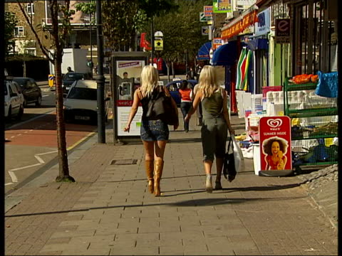 blonde women walking down street england london leyton ext back view two women with long blonde hair wearing high heels and tight clothing walking... - high heels stock videos & royalty-free footage