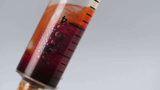 cu blood filling clear liquid in syringe - prescription medicine stock videos & royalty-free footage
