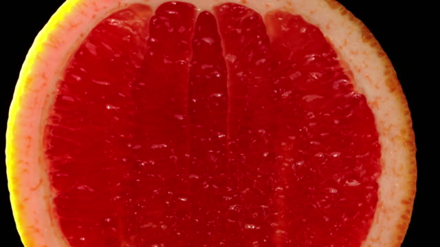 Blood Grapefruit slowly zoom in with black background