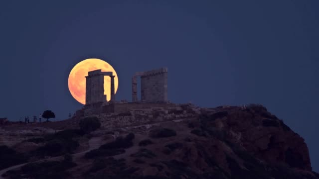 blood moon rises above the ancient temple of poseidon in cape sounion southeast of athens greece from the beginning to the end all the phases of the... - sounion stock videos and b-roll footage