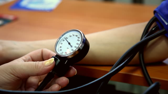 blood pressure measurement - instrument of measurement stock videos and b-roll footage