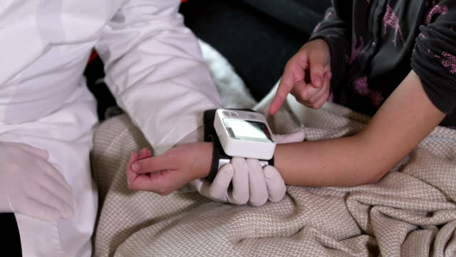 blood pressure measuring - bedclothes stock videos & royalty-free footage