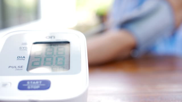 blood pressure monitoring device test blood pressure for patient , slow motion - gauge stock videos & royalty-free footage