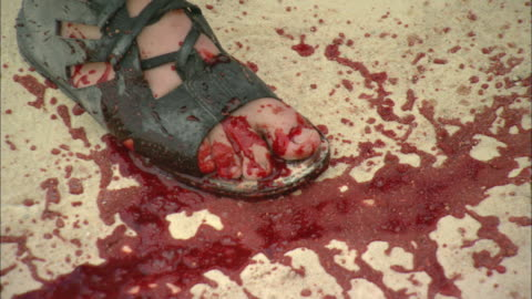blood spills on a man's right foot and sandal during a reenactment of a roman blood spectacle. - historical reenactment stock videos & royalty-free footage