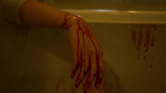 vídeos de stock e filmes b-roll de bloody hand. - blood