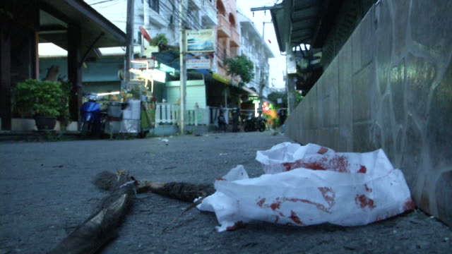 bloody rags at the site of an explosion in hua hin thailand a series of coordinated blasts across southern thailand including hua hin and phuket... - ぞうきん点の映像素材/bロール
