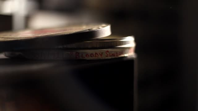 stockvideo's en b-roll-footage met bloody sunday 1972 film reels being played on a steenbeck - bbc archives