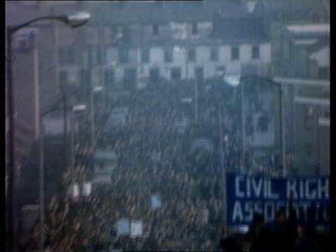 january 1972 mass civil rights marchers along street ms soldier sheltering behind fortified landrover as shots heard sot ms people along carrying... - 25th anniversary stock videos and b-roll footage