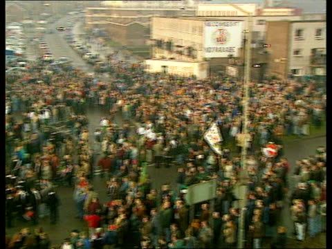bloody sunday 25th anniversary; northern ireland: derry/ londonderry: large banner held across road as relatives of those who died holding crosses as... - irvine video stock e b–roll