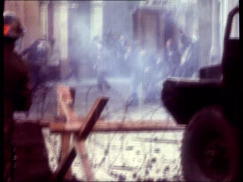 bloody sunday lib 1972 paratroopers behind barricade firing tear gas as demonstrators throw rocks paras co lt col derek wilford - 1972 stock videos & royalty-free footage
