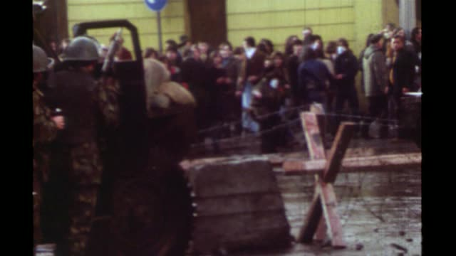 british soldier arrested on suspicion of murder s27110601 3011972 ireland derry / londonderry ext bloody sunday various of demonstrators throwing... - derry northern ireland stock videos & royalty-free footage
